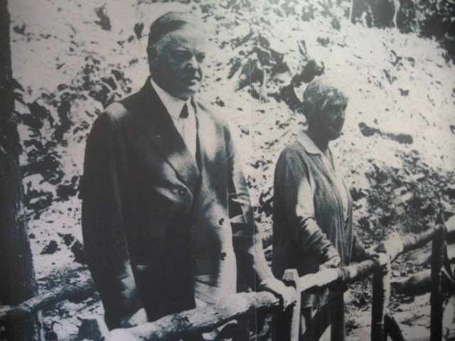President and Mrs. Hoover on a bridge at Camp Rapidan