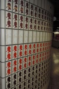 Hundreds of Holmes heads - fun tiles in the Baker Street tube station, London