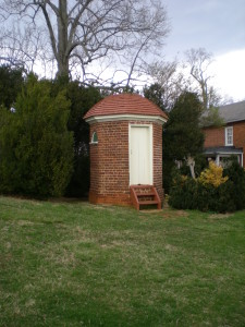 The infamous octagonal privy, discreetly hidden behind some trees at Jefferson's Poplar Forest